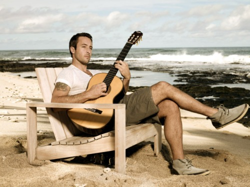 Alex O'Loughlin playing the guitar2