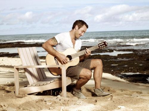 Alex O'Loughlin playing the guitar3