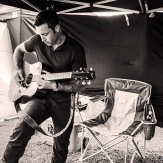 Alex showing off his guitar skills in the cast tent @rachelcerettophotography