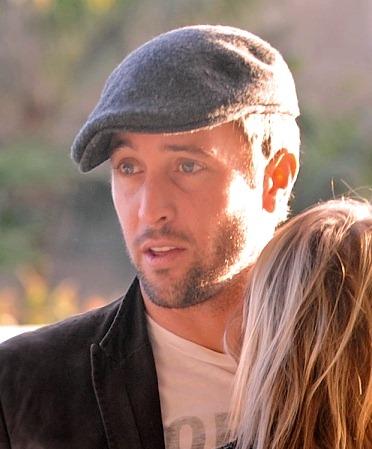 ©NATIONAL PHOTO GROUP Alex O'Loughlin kisses his girlfriend Amber Clayton goodbye at LAX Jan. 3rd, 2011